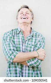 happy smiling mature man in forties with blond hair and blue eyes.