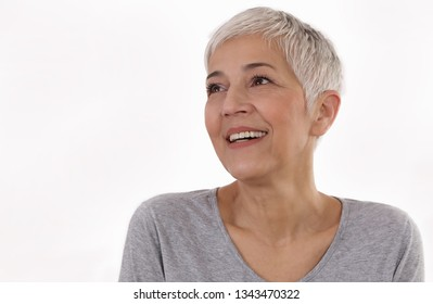 Happy Smiling Mature Woman Portrait on white background. Older skin care, beauty concept.