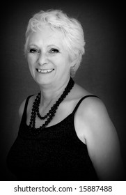 Happy smiling mature woman with white hair