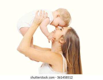 Happy smiling mother with baby having fun together on white background