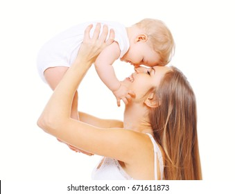 Happy smiling mother and baby having fun on a white background