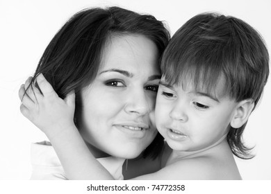 Happy smiling mother with child, closeup portrait