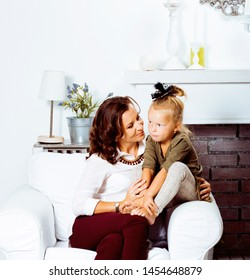 happy smiling mother with little cute daughter at home interior, casual look modern real family, lifestyle people concept