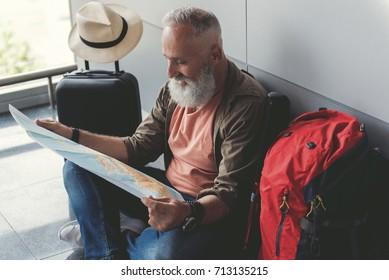 Happy smiling old man choosing route