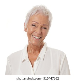 happy smiling older lady in her sixties with trendy white short haircut