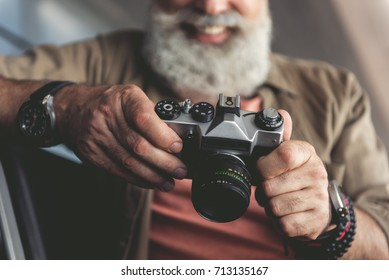 Happy smiling photographer using modern device