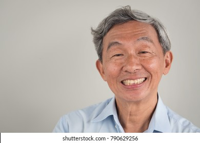 happy smiling positive old senior retired old man face portrait; happy positive good lifestyle of senior old man; gray hair handsome aged Asian Chinese senior elder old man, grandpa, grandfather model