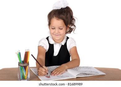happy smiling pretty girl drawing something with pencils