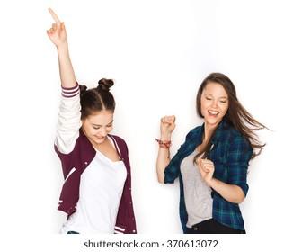 happy smiling pretty teenage girls dancing