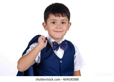 Happy smiling schoolboy with school bag isolated on white