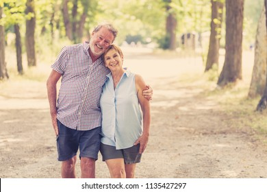 Happy smiling senior couple in love, relaxing, dancing and having fun in the park. Being together strong, retirement happy life concept.