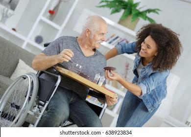 happy smiling senior man and nurse