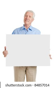 Happy smiling senior man showing blank placard to write it on your own text, isolated on white background