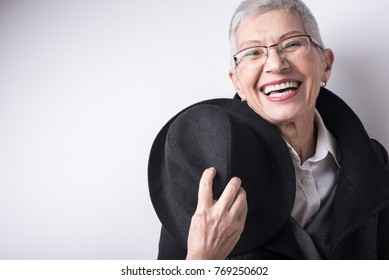 Happy smiling senior old woman with style and class