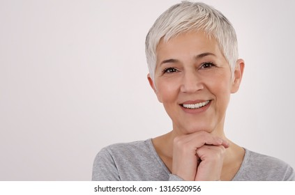 Happy Smiling Senior Woman Portrait on white background. Older skin care, beauty concept.
