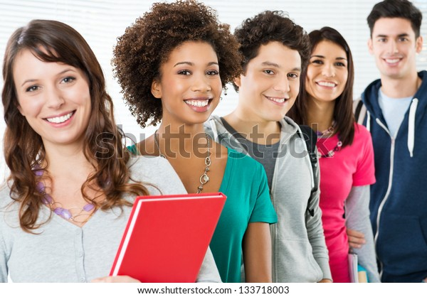 Happy Smiling Students Standing In Row