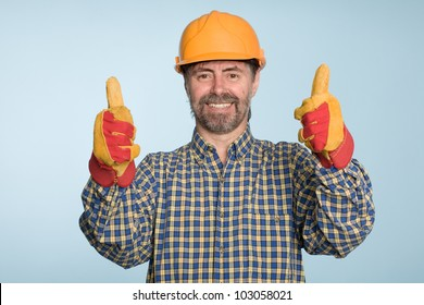 Happy smiling successful builder with thumbs up gesture.
