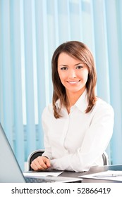 Happy smiling successful businesswoman at office