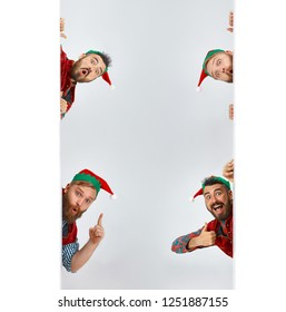 The happy smiling surprised friendly men dressed like a funny gnome or elf posing on an isolated gray studio background. The winter, holiday, christmas concept