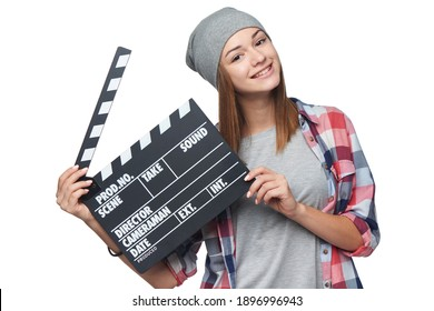 Happy smiling teen girl holding clap board, over white background