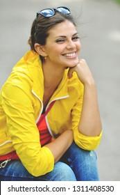 Happy smiling teenager girl outdoor portrait