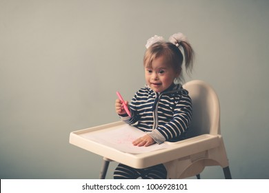 Happy and smiling toddler girl with down syndrome on child chair, toning and lifestyle