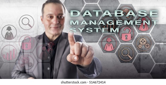 Happy, smiling, but uncompromising, male database expert is touching DATABASE MANAGEMENT SYSTEM on an interactive control screen. Information technology concept and data management metaphor.