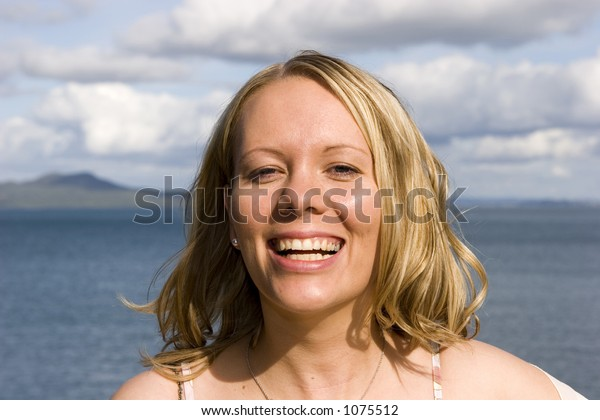 Happy smiling woman at the beach