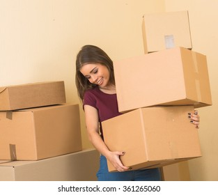 Happy smiling woman carrying carton boxes