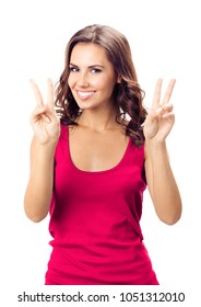 Happy smiling woman in casual smart red clothing, showing two fingers or victory gesture, isolated over white background. Emotional concept.