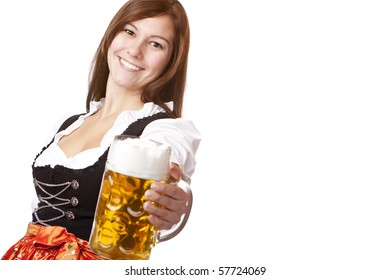 Happy smiling woman in dirndl dress holding Oktoberfest beer stein. Isolated on white background.