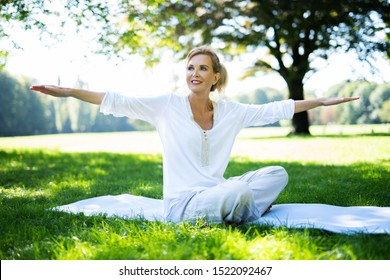 happy smiling woman doing exercises in the park