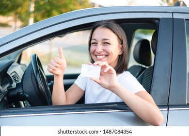 Happy smiling woman with driving license ready to drive
