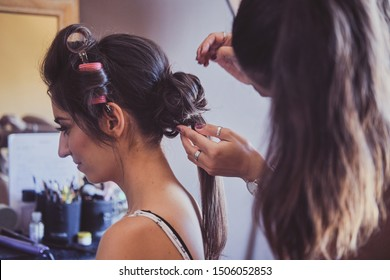 Happy smiling woman is getting festive hair comb from experienced hairdresser.