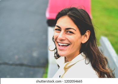 Happy smiling woman in her 20s, outside looking up