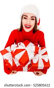 Happy smiling woman holding boxes with present on xmas with red lips.