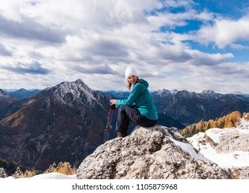 Happy smiling woman in Italian Alps mountains Europe.