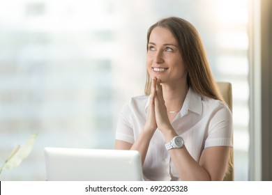 Happy smiling woman looks up, puts hands together in prayer, feels grateful, hopes for successful plan realization, believes in business success, wishes dream come true, visualizes future, head shot