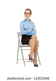 happy and smiling woman on a chair  in specs