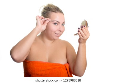 Happy smiling woman plus size tweezing eyebrows isolated on white background. The modern concept of eyebrow correction, beauty, fashion, skin care.