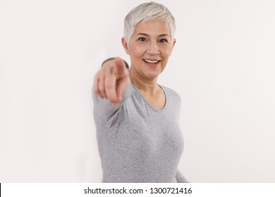 Happy smiling woman pointing on you. Choice, marketing concept