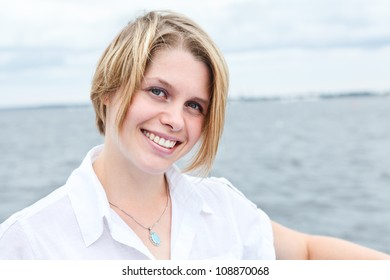 Happy smiling woman portrait looking at camera