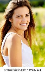 Happy smiling woman portrait outdoors