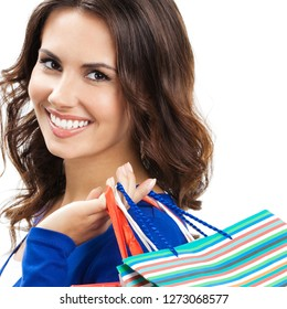 Happy smiling woman with shopping bags, isolated against white background