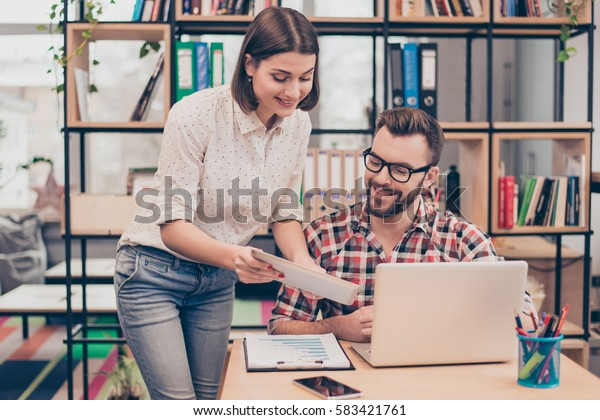 Happy smiling woman showing plan of work to her partner
