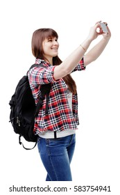 Happy smiling woman taking selfie photo on smartphone. attractive brunette in jeans and a plaid shirt In Use your mobile phone