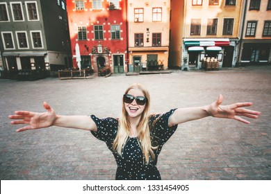 Happy smiling woman walking in Stockholm travel sightseeing fashion lifestyle summer vacations in Sweden