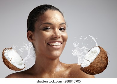 happy smiling woman with a wet skin from coconut milk.