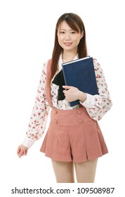 happy and smiling young asian woman with book