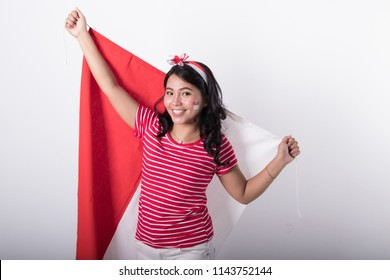 happy smiling young asian woman with indonesian flag